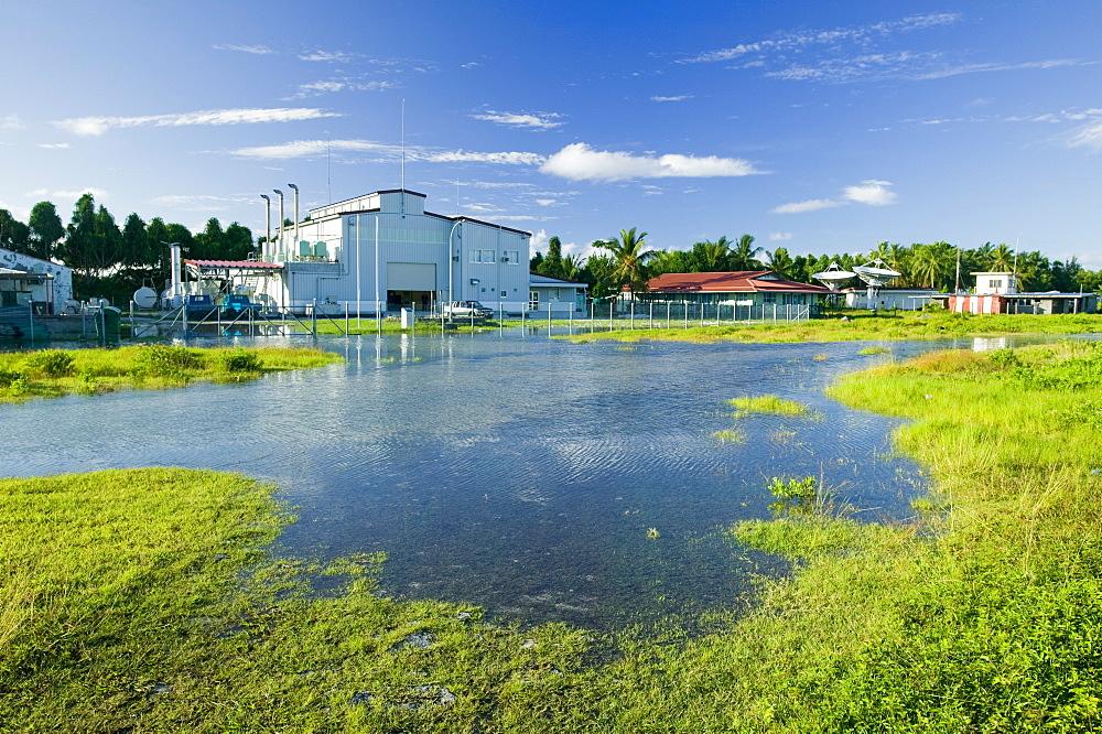 Sea water incursion onto Funafuti Atoll the main island, as global warming induced sea level rise threatens to flood these low lying islands, Funafuti, Tuvalu, Pacific