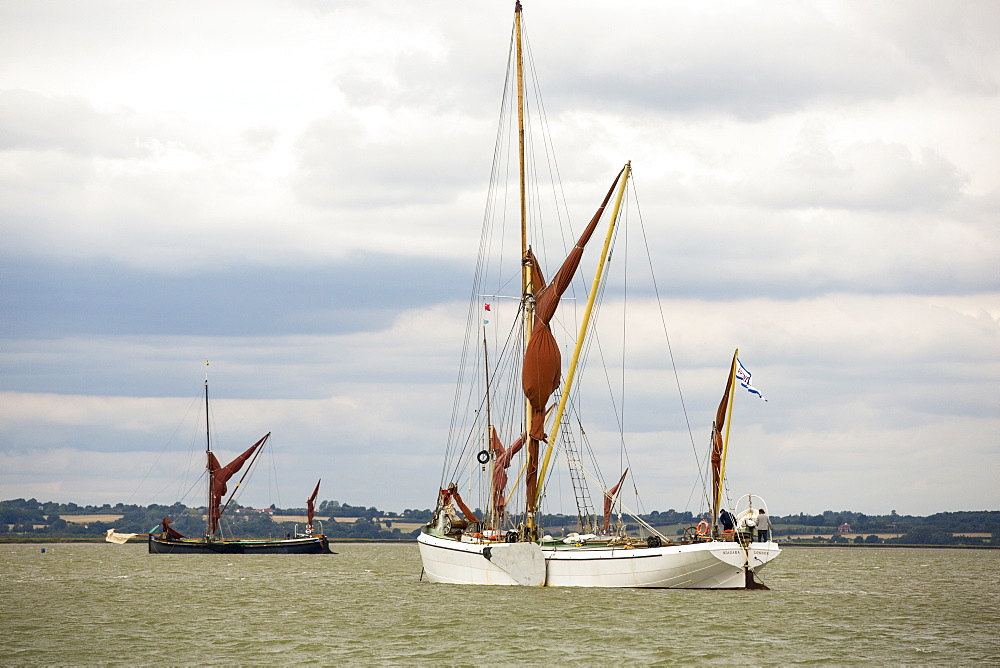 Traditional wooden Smack fishing boats off Brightlingsea, Essex, UK. - 911-10869