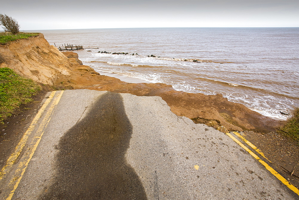 A road eroded and dropping off into the North sea at Happisburgh, Norfolk, a rapidly eroding section of coastline, UK. - 911-10890