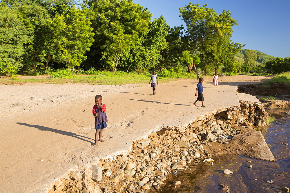 In mid January 2015, a three day period of excessive rain brought unprecedented floods to the small poor African country of Malawi. It displaced nearly quarter of a million people, devastated 64,000 hectares of land, and killed several hundred people. This shot shows a road and bridge washed away near Chikwawa.