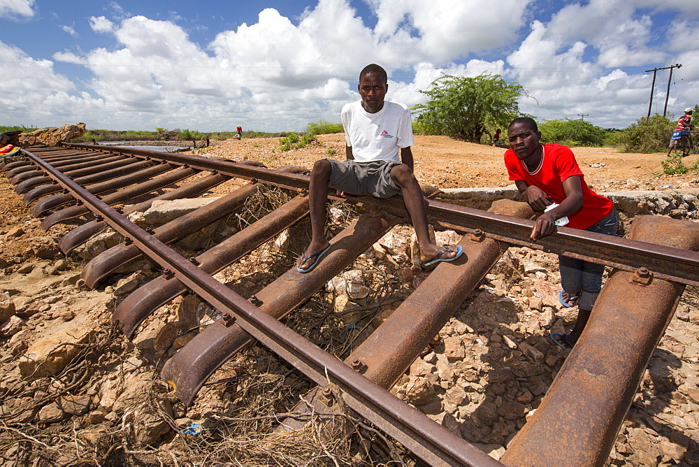 In mid January 2015, a three day period of excessive rain brought unprecedented floods to the small poor African country of Malawi. It displaced nearly quarter of a million people, devastated 64,000 hectares of land, and killed several hundred people. This shot shows a railway line that was washed away in Bangula. - 911-10897