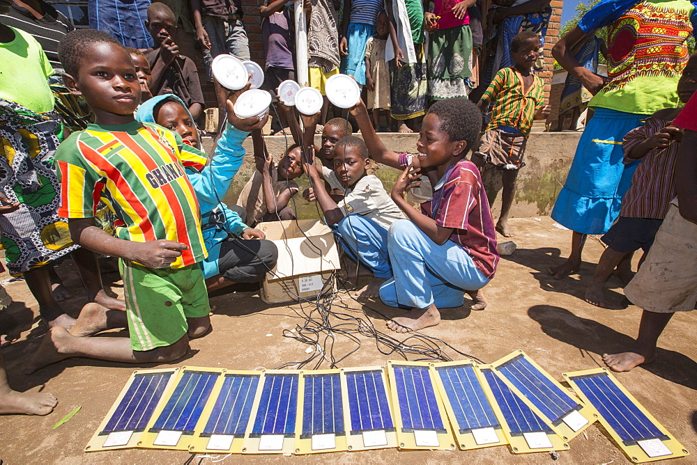 In mid January 2015, a three day period of excessive rain brought unprecedented floods to the small poor African country of Malawi. It displaced nearly quarter of a million people, devastated 64,000 hectares of land, and killed several hundred people. This shot shows solar powered lamps in a refugee camp near Chikwawa. - 911-10905