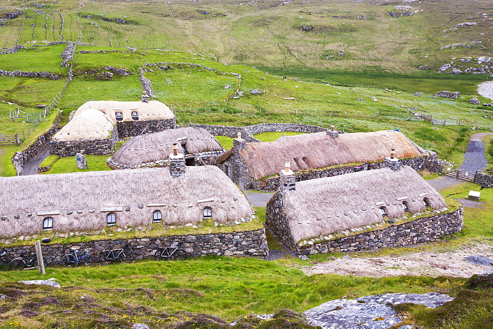 The Black House village at Garenin near Carloway on the Isle of Lewis, Outer Hebrides, Scotland, UK. These ancient traditional houses have been preserved, after they were abandoned finally in the 1970's until then people were living in them. - 911-10906