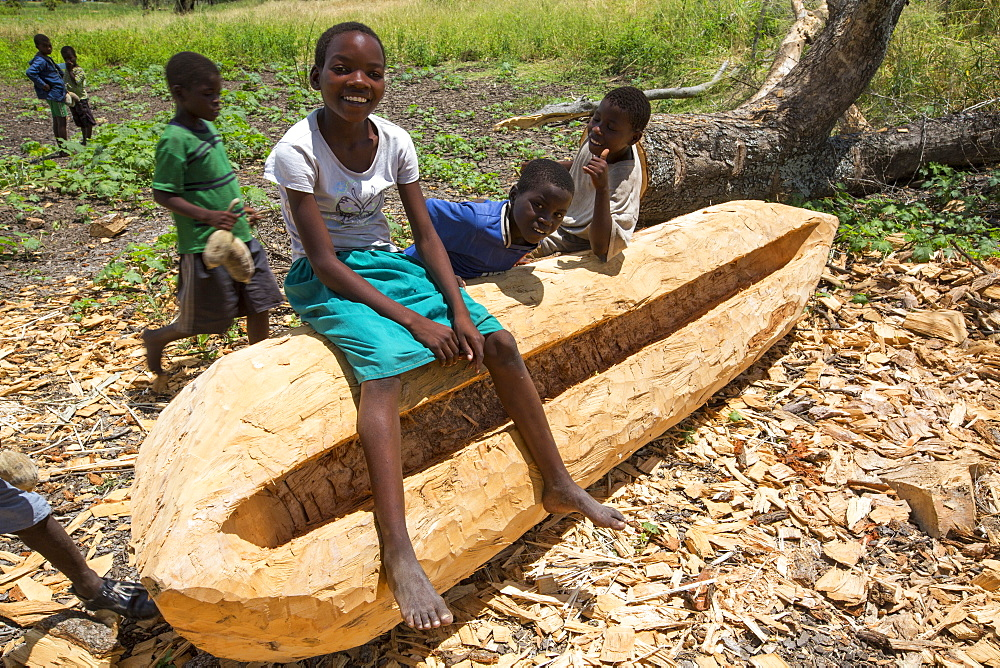 A traditional dug out canoe being constructed in Malawi, Africa.