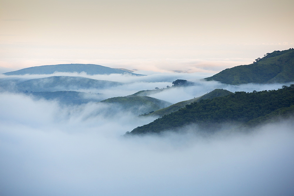 Morning Mist spilling down from the plateau into the lower shire river valley in Malawi, Africa.