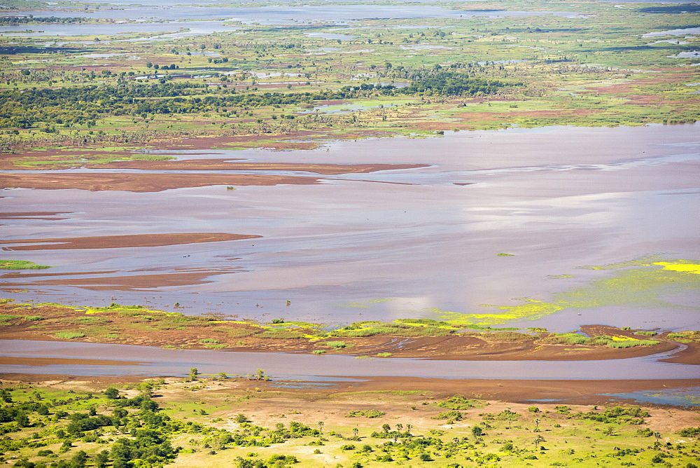 In mid January 2015, a three day period of excessive rain brought unprecedented floods to the small poor African country of Malawi. It displaced nearly quarter of a million people, devastated 64,000 hectares of land, and killed several hundred people. This shot taken from the air shows farmland buried under flood debris, and still flooded land. - 911-10934