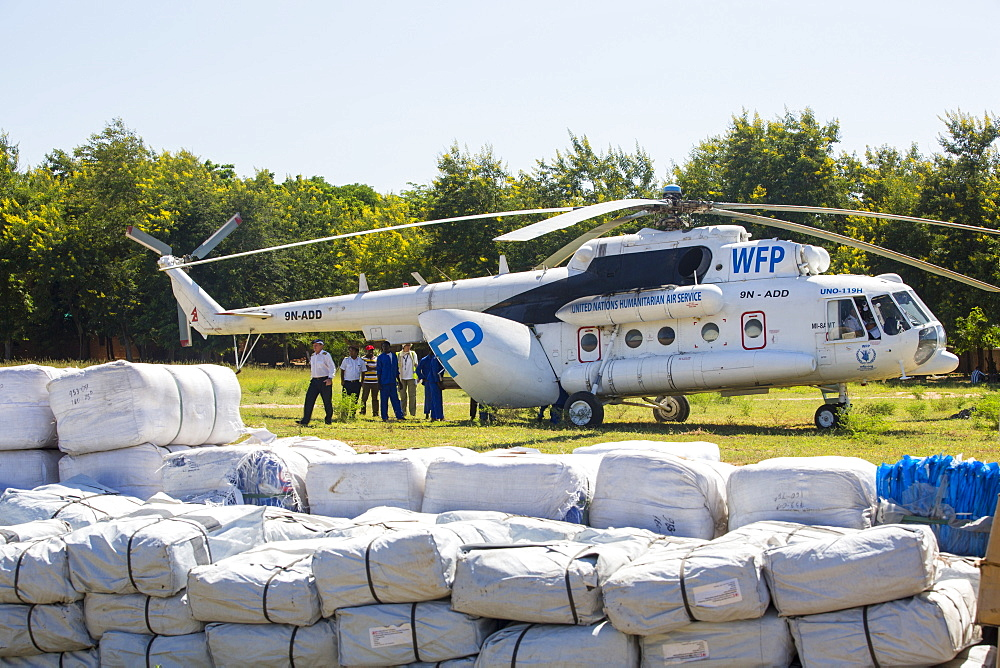 In mid January 2015, a three day period of excessive rain brought unprecedented floods to the small poor African country of Malawi. It displaced nearly quarter of a million people, devastated 64,000 hectares of land, and killed several hundred people. This shot shows A Russian Mi8 helicopter being used by the United Nations, World Food Program to deliver food aid to areas still cut off by the flooding around Makhanga and Bangula. - 911-10948