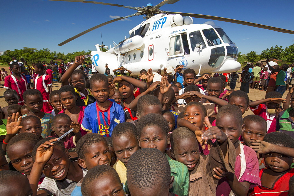 In mid January 2015, a three day period of excessive rain brought unprecedented floods to the small poor African country of Malawi. It displaced nearly quarter of a million people, devastated 64,000 hectares of land, and killed several hundred people. This shot shows A Russian Mi8 helicopter being used by the United Nations, World Food Program to deliver food aid to areas still cut off by the flooding, around Bangula and Mkhanga.