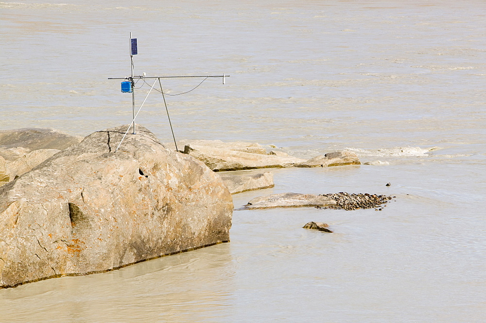 Scientific equipment measuring the meltwater from the Russell Glacier that drains the Greenland Ice Sheet 26 km inland from Kangerlussuaq, Greenland, Polar Regions