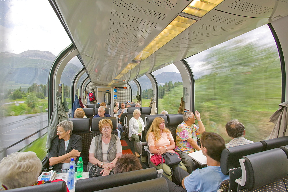 Passengers on the Bernina Glacier express that goes from Chur in Switzerland to Tirano in Italy, Europe