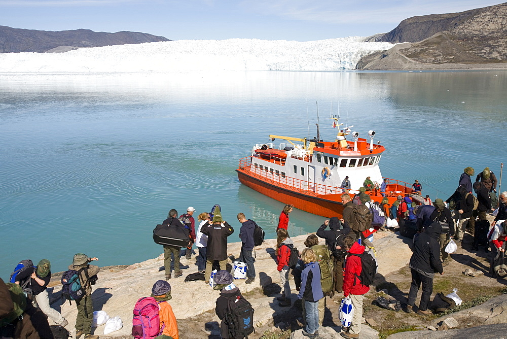 Passengers landing at Camp Victor by the Eqip Sermia glacier that is receding rapidly due to global warming on the west coast of Greenland, Polar Regions