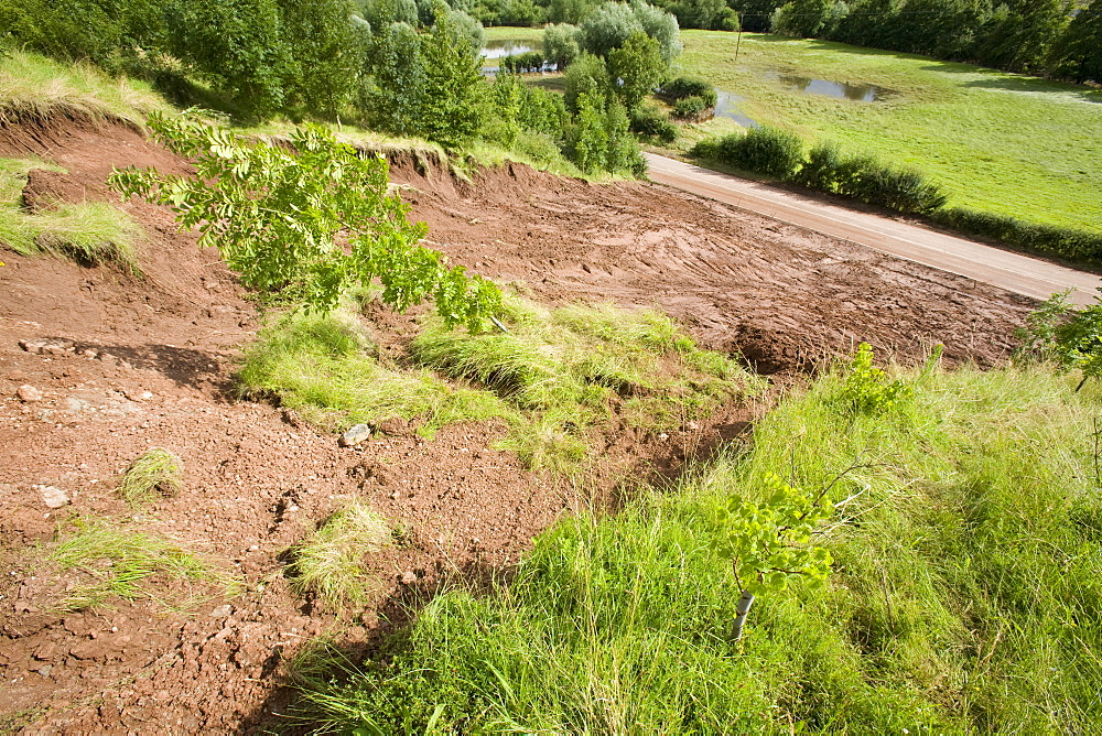A landslide caused by torrential rain waterlogging the ground which blocked a road for a week in Shropshire, England, United Kingdom, Europe
