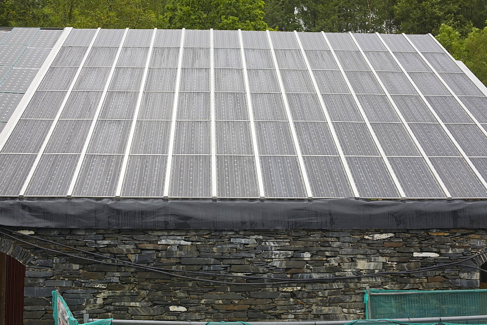 Solar panels on a building at the Centre for Alternative Technology in Machylleth, Wales, United Kingdom, Europe