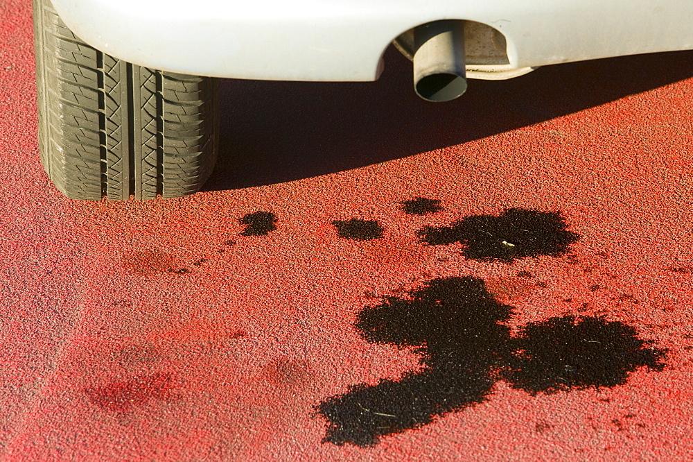 An oil leak in a car park