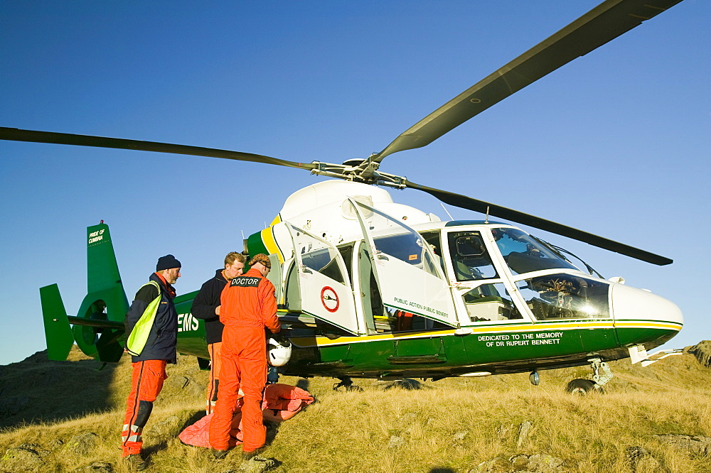 An air ambulance attending a mountain rescue in the Lake District, Cumbria, England, United Kingdom, Europe