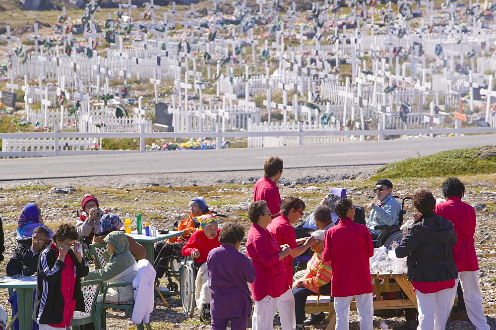 The old folks of Ilulissat having a day out in front of the town's cemetery, Greenland, Polar Regions