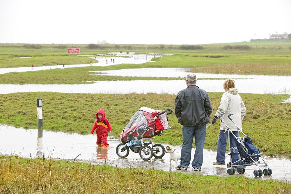 A flooded road near Sunderland Point, Morecambe Bay, Lancashire, England, United Kingdom, Europe