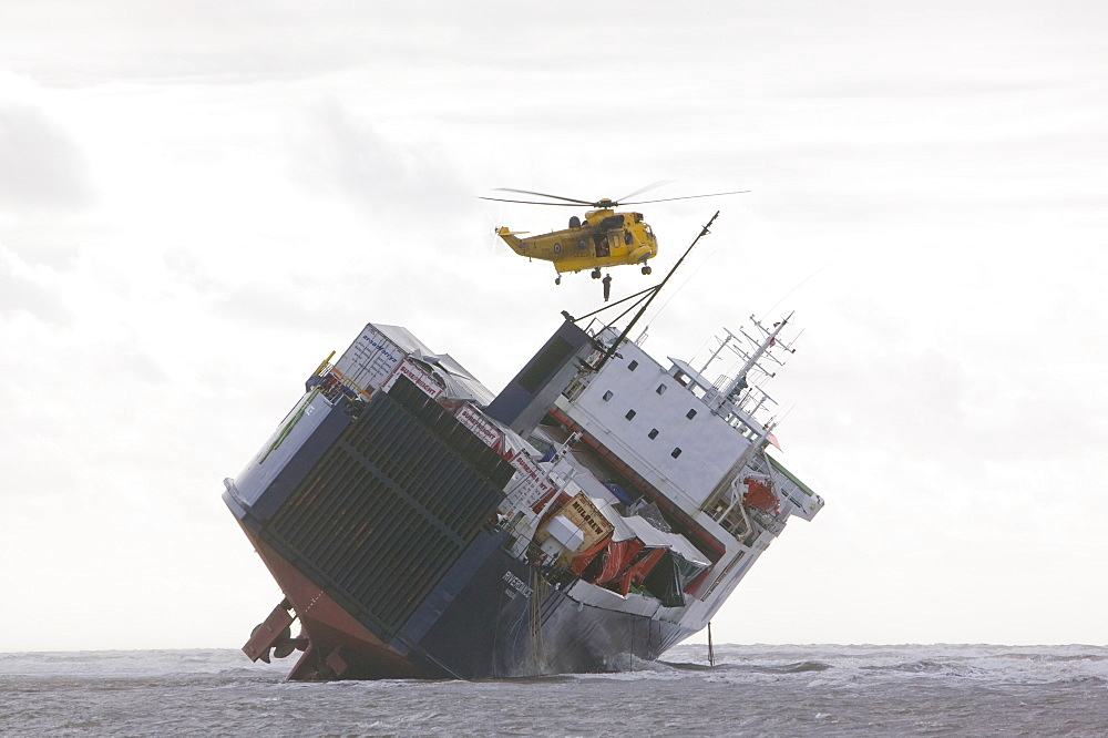 An RAF Sea King Helicopter prepares to drop salvage experts onto the Riverdance washed ashore off Blackpool, Lancashire, England, United Kingdom, Europe