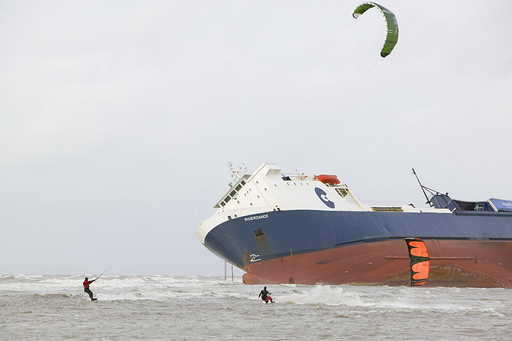 Kite surfers in front of The Riverdance, a ship washed ashore off Blackpool, Lancashire, England, United Kingdom, Europe