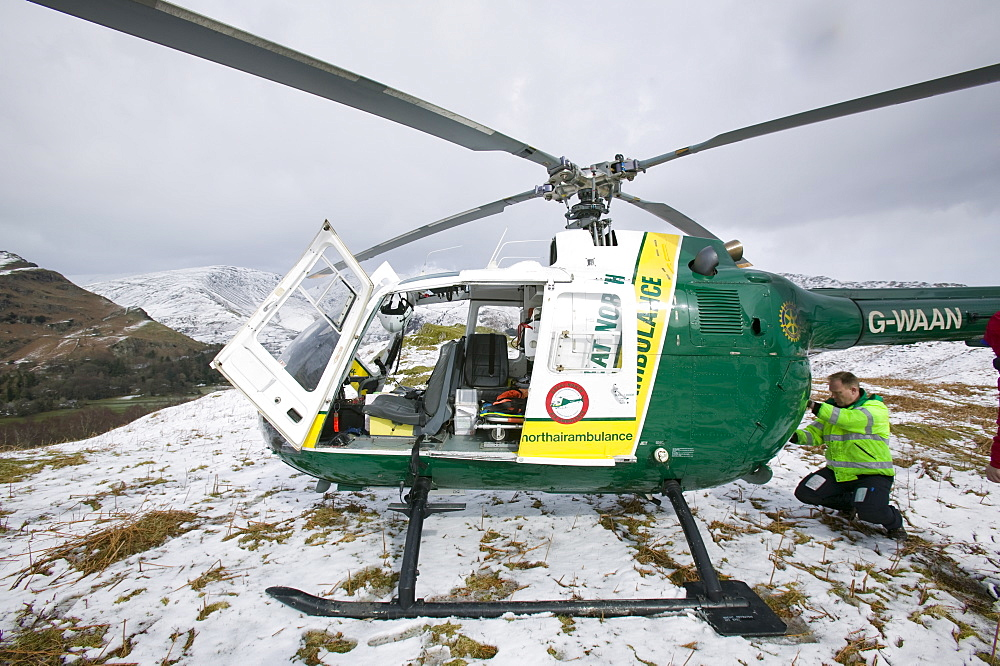 An air ambulance at the site of an injured walker on Silver Howe above Grasmere, Lake District, Cumbria, England, United Kingdom, Europe