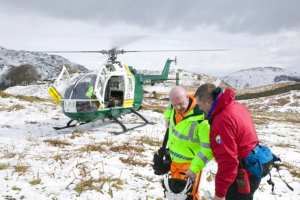 An air ambulance attending a mountain rescue incident near Grasmere, Lake District, Cumbria, England, United Kingdom, Europe