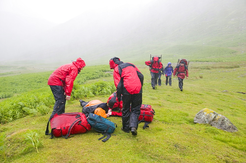 Members of Langdale Ambleside mountain rescue Team treat a collapsed walker suffering from hypothermia in the Lake District, Cumbria, England, United Kingdom, Europe