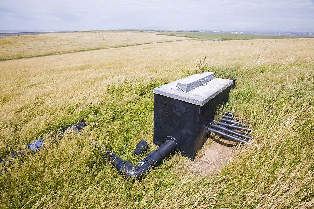 Capturing methane from an old land fill rubbish dump on Walney Island near Barrow in Furness to convert to green electricity, Cumbria, England, United Kingdom, Europe