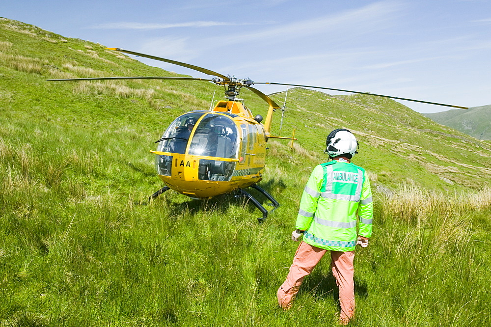 An air ambulance attends a mountain rescue on Wansfell in the Lake District, Cumbria, England, United Kingdom, Europe