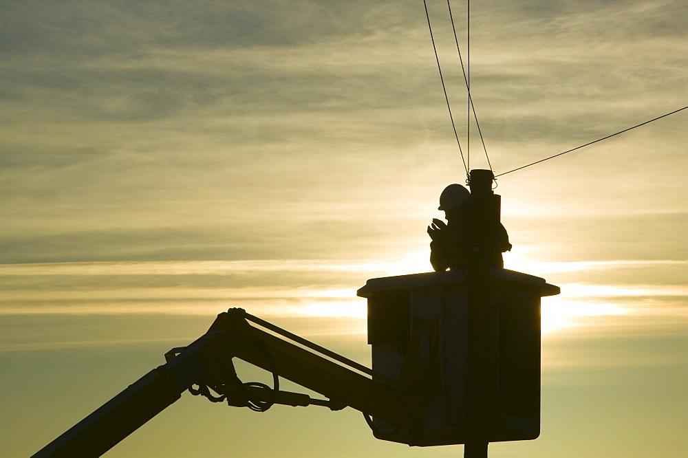 A BT worker fixs telephone lines, Cumbria, England, United Kingdom, Europe