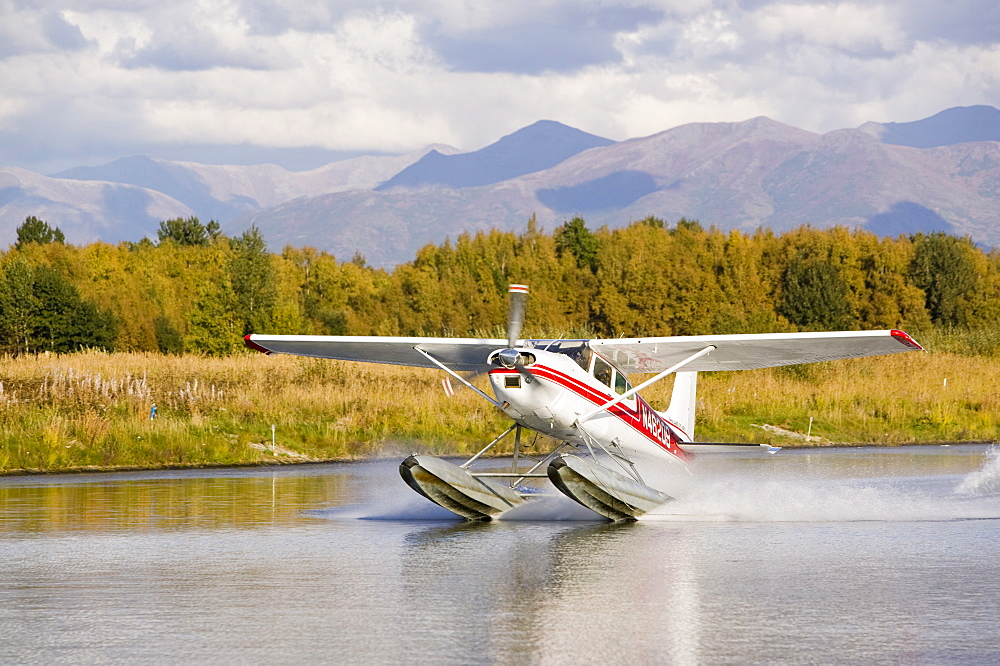 A float plane flying into Anchorage, Alaska, United States of America, North America