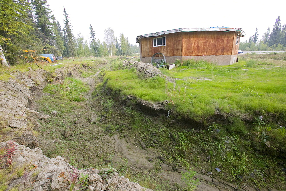 House collapsing due to global warming-induced permafrost melt, Fairbanks, Alaska, United States of America, North America