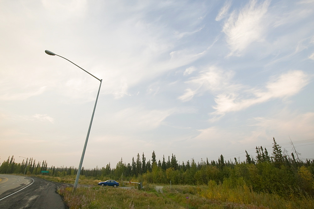 A lamp post collapsing due to global warming-induced permafrost melt, in Fairbanks, Alaska, United States of America, North America