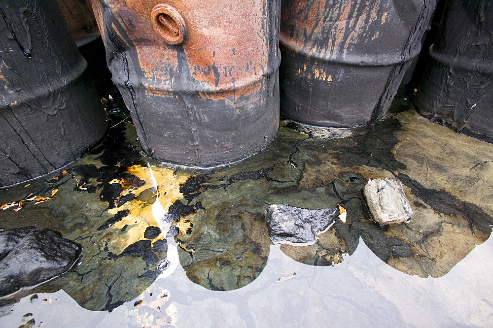 Abandoned barrels of leaking waste oil on the tundra at Nome in Alaska, United States of America, North America