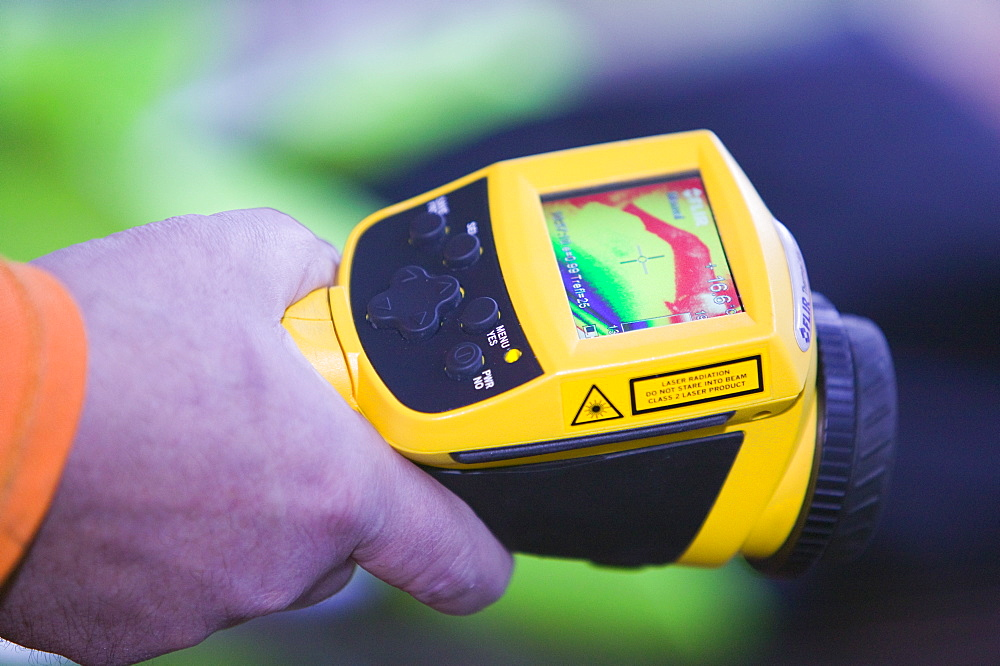 A man uses a thermal imaging camera to test how dried out a Carlisle house is after the floods, Cumbria, England, United Kingdom, Europe