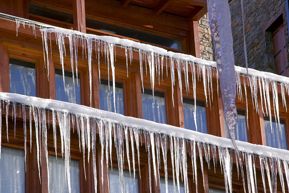 Icicles hanging from a chalet roof in the Andorran ski resort of Soldeu el Tarter, Andorra, Europe