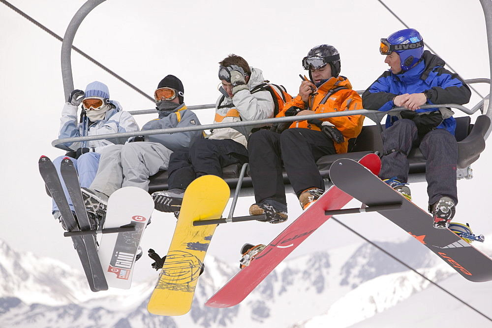 Skiers on a ski lift in the Andorran ski resort of Soldeu, Andorra, Europe