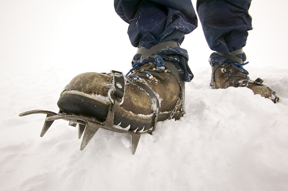 A climber wearing crampons