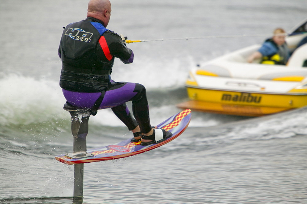Waterskiers on Lake Windermere in the Lake District, Cumbria, England, United Kingdom, Europe