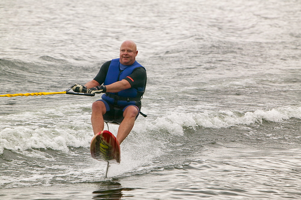 Waterskier on Lake Windermere in the Lake District, Cumbria, England, United Kingdom, Europe