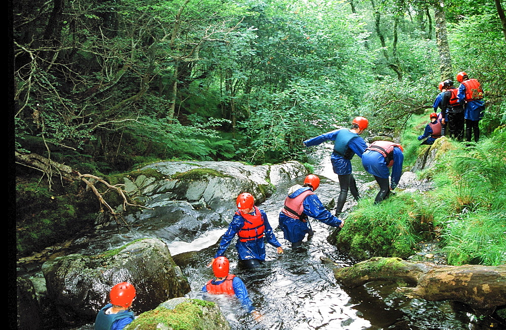A group of teenagers canyoning in Mid Wales, United Kingdom, Europe