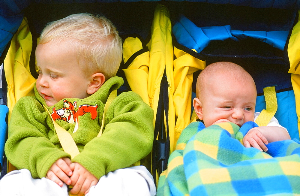 Young children in a push chair