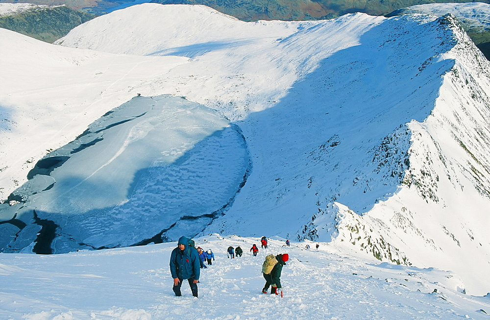 Climbers ascend Helvellyn from Striding Edge in the Lake District National Park, Cumbria, England, United Kingdom, Europe