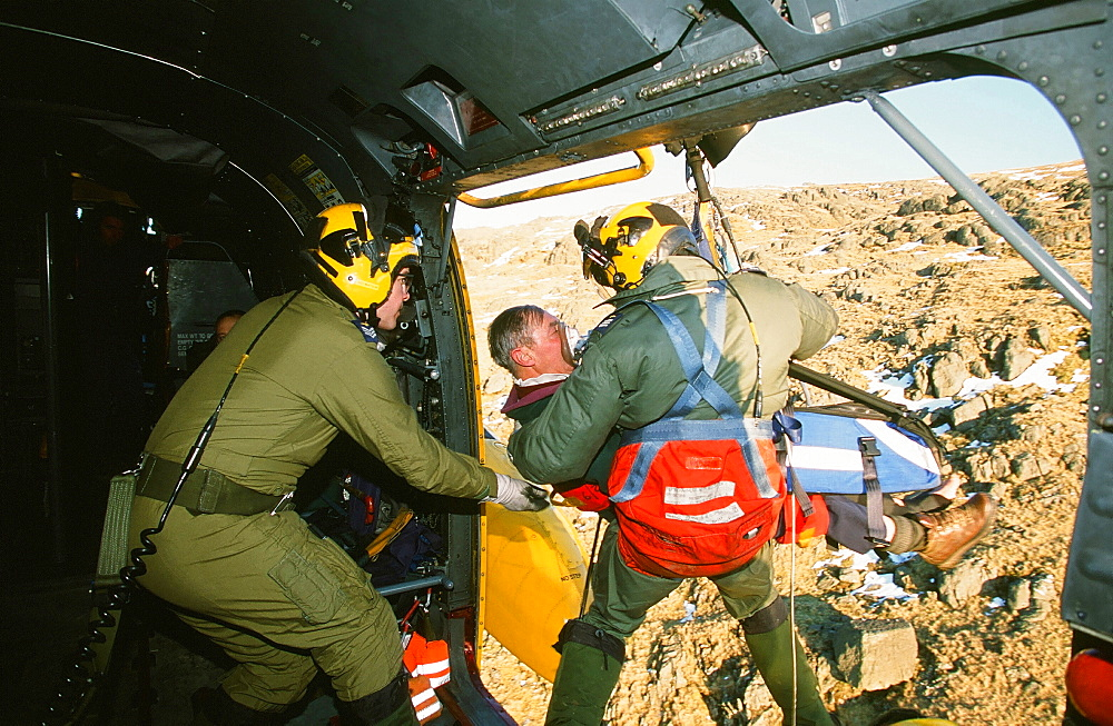RAF Sea King Helicopter crew attend a mountain rescue incident in the Lake District, Cumbria, England, United Kingdom, Europe