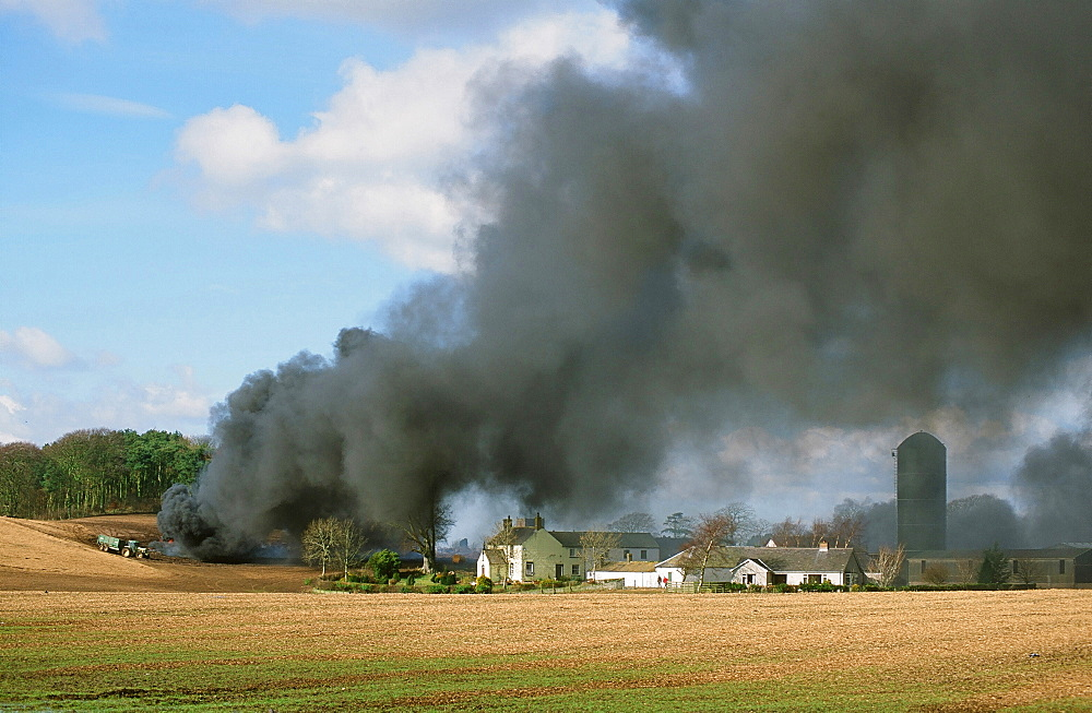 A funeral pyre burning infected animals with Foot and Mouth Disease near Longtown in Cumbria, England, United Kingdom, Europe