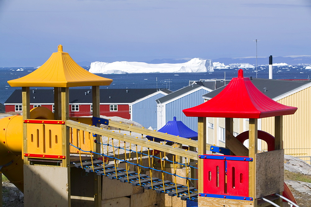 Childrens playground in Ilulissat with icebergs from the Jacobshavn icefjord behind, Greenland, Polar Regions