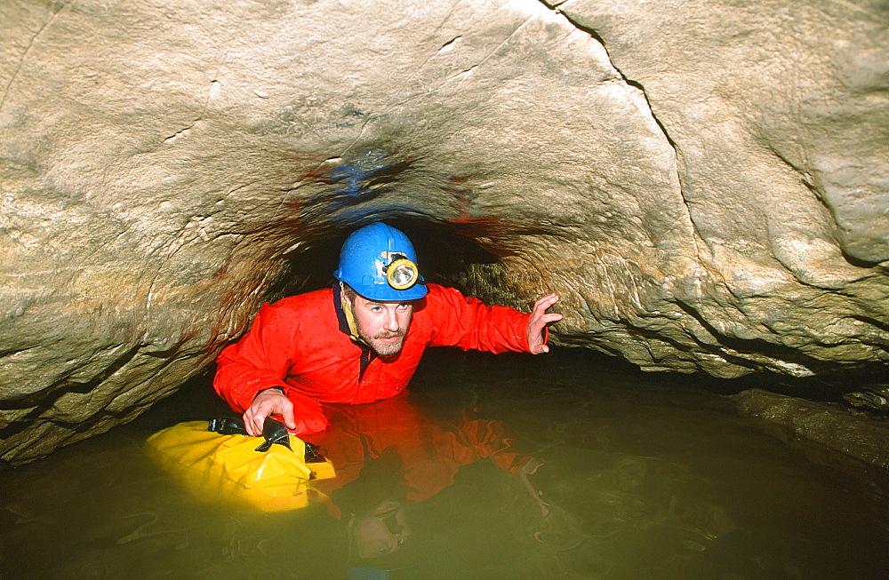 A caver in Valley Entrance, Kingsdale, Yorkshire Dales, Yorkshire, England, United Kingdom, Europe