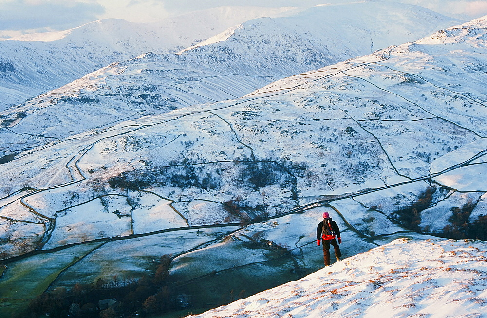 A man on Red Screes in the Lake District National Park, Cumbria, England, United Kingdom, Europe