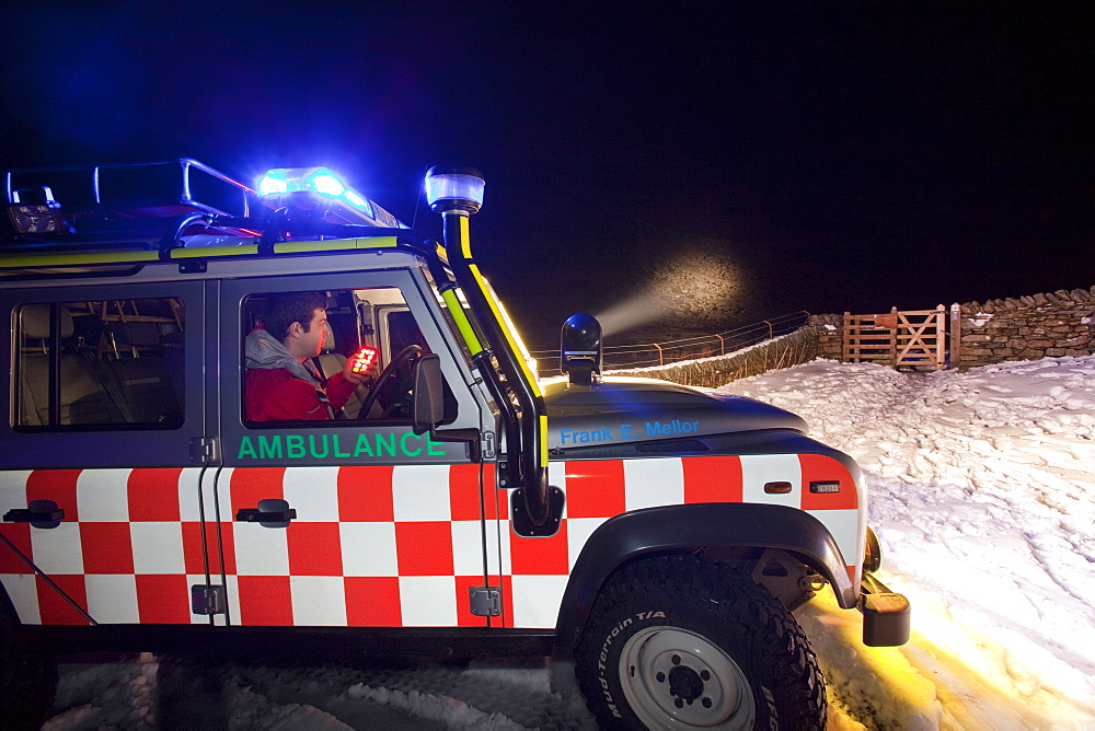 A Langdale Ambleside Mountain Rescue Team Landrover out at night below Red Screes in the Lake District, Cumbria, England, United Kingdom, Europe - 911-3636