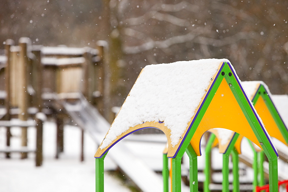 Playground swings in the snow in Ambleside, Cumbria, England, United Kingdom, Europe