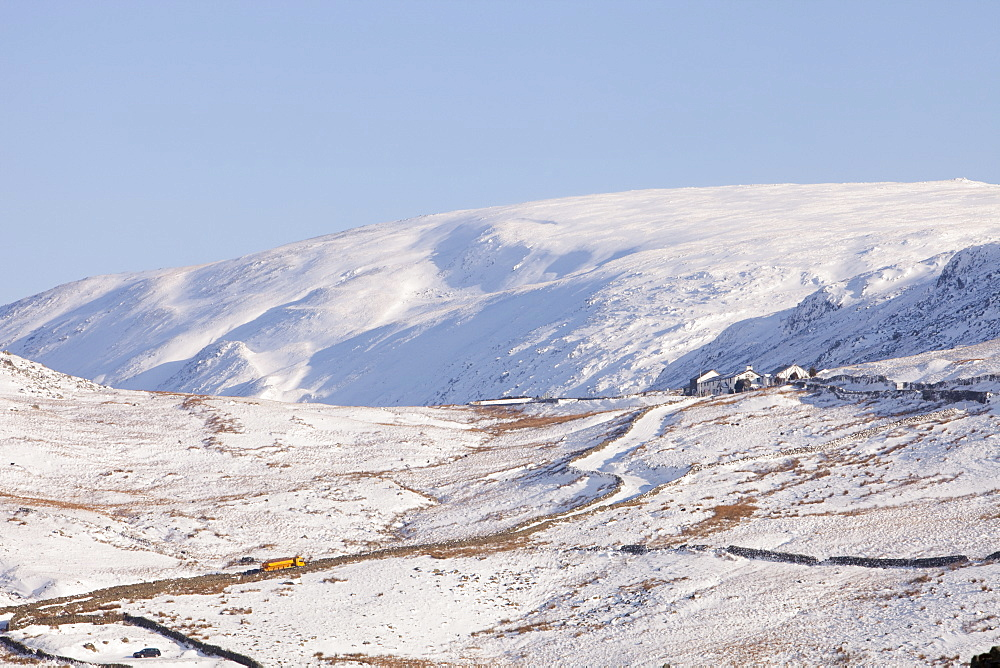 A snow plough trying to keep Kirkstone Pass open in the snow, Lake District, Cumbria, England, United Kingdom, Europe